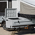 Clipper's Super Sliding Storage box enables full, easy accessibility even when the camper is set up. (1285SST) May Show Optional Features. Features and Options Subject to Change Without Notice.