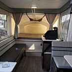 Clipper 1285SST Front to Back Showing Dinette Slideout, Cooktop, Queen Size Bunk End, Gaucho Couch and Storage