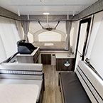 Clipper 108ST Back to Front Showing Dinette Seating, Gaucho Couch, Entry Door, Storage, Cooktop, and Queen Size Bunk End