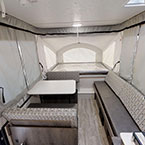 Clipper 107LS Front to Back Showing Gaucho Couch, Dinette Seating w/Storage, and Full Size Bunk End
