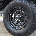 Black tire rim May Show Optional Features. Features and Options Subject to Change Without Notice.