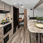 The 184BHS features a door side kitchen with rear double over double bunk beds, rear bathroom and U-shaped dinette slide. May Show Optional Features. Features and Options Subject to Change Without Notice.
