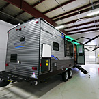 Rear 3/4 View of Door Side with Camp Kitchen Open, Awning Extended with LED Lights (Shown in Green), Optional Solid Steps Extended