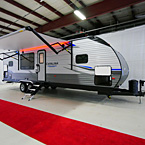 Front 3/4 View with Awning Extended with LED Lights (Shown in Red), Pass-Through Storage Open
