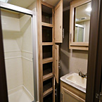 3 Linen Doors Opened up with 6 Cubbies, Part of Medicine Cabinet and Vanity Shown