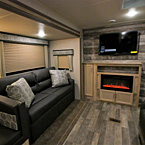 "Optional Tri-Fold Sofa Shown in Java Décor with 2 Pillows, Entertainment Center- with 39"" T.V., Optional 30"" Fireplace, 1 Door Next to Fireplace, 2 Doors Below Fireplace